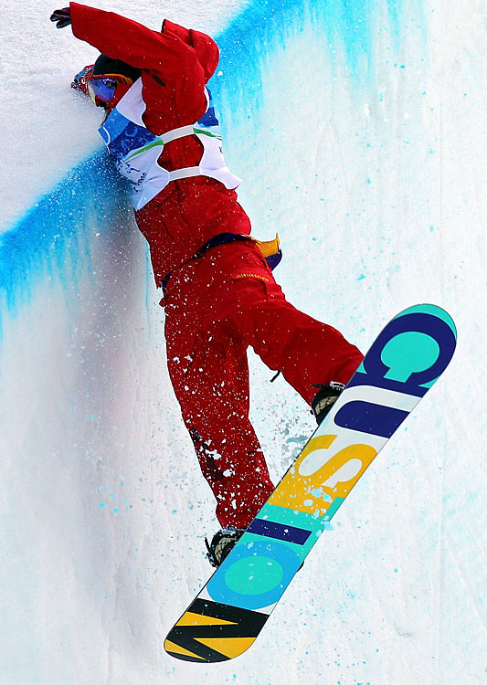 Chinese snowboarder Shi Wancheng falls while competing in the men's halfpipe at the Vancouver Olympics.