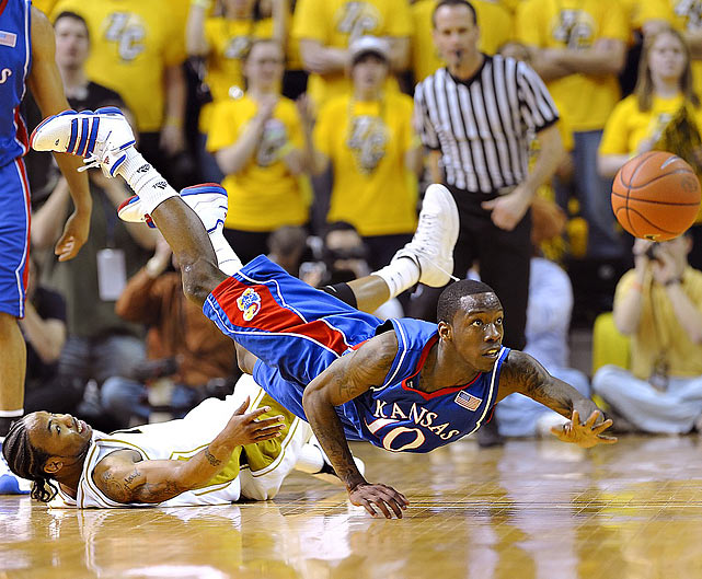 Kansas Jayhawks guard Tyshawn Taylor watches the ball slip away during Kansas' 77-56 victory at Mizzou Arena in Columbia, Mo.