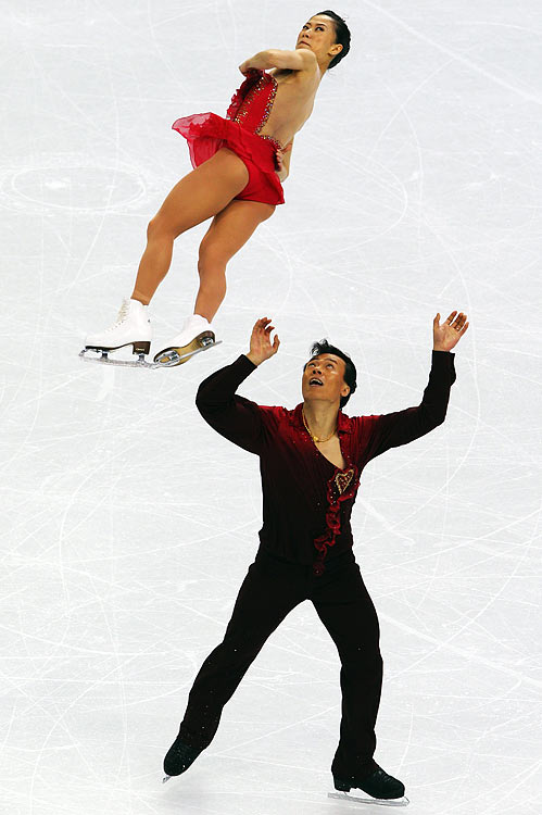 Chinese skaters Xue Shen (left) and Hongo Zhao (right) compete in the pairs free program during the Vancouver Olympics.  The pair set a new world record for overall combined score  (216.57 points) en route to a gold medal.