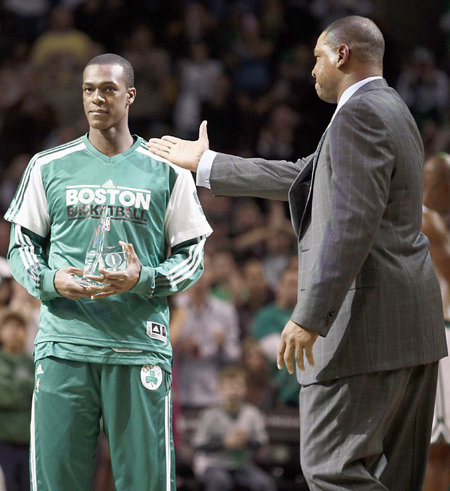 Celtics coach Doc Rivers presents Rondo with awards for leading the league in steals and being named to the all-defensive team.