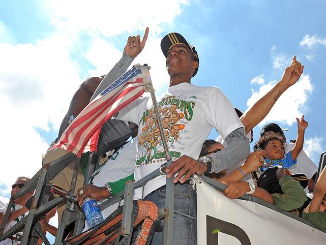 Rondo celebrates the championship during a Duck Boat tour through Boston.