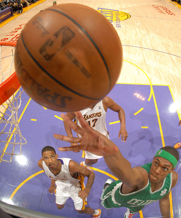 Boston's new Big Three of Pierce, Allen and Garnett led the Celtics to the 2007-08 NBA championship. Rondo averaged 11 points, five assists and four rebounds per game and finished in the top five for Most Improved Player. In this photo, Rondo tips home a shot during the Finals against the Lakers.