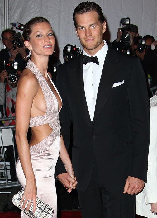 """The hoopla began in August, when Brady showed up to Patriots training camp with his new look. Most people suspected the woman behind the long locks was his wife, Gisele. Brady confirmed this during a radio appearance when WAAF's Greg Hill asked if there were anything he could do to make Brady cut his hair. The QB responded, """"You'll have to speak to my wife about that."""""""