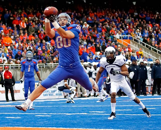 Boise State may be out of the national championship picture, but it still ended its WAC tenure in style. Kellen Moore passed for three touchdowns (two to tight end Kyle Efaw) and ran for another as the Broncos (11-1, 7-1 WAC) wrapped up a share of the conference crown before leaving for the Mountain West next season.