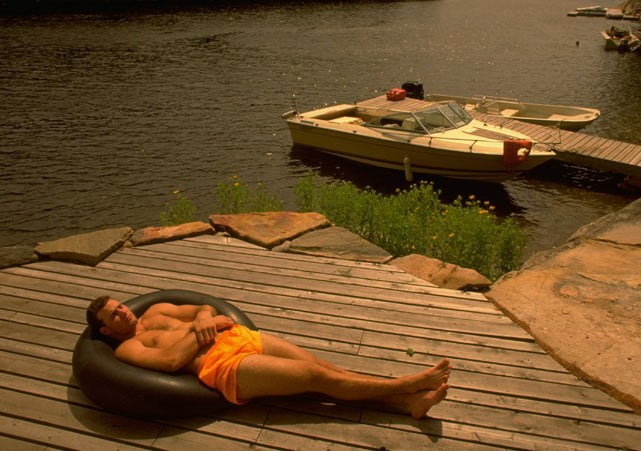 Eric Lindros relaxes on a dock in Honey Harbour, Canada. He was traded to Philadelphia shortly after this photo was taken.