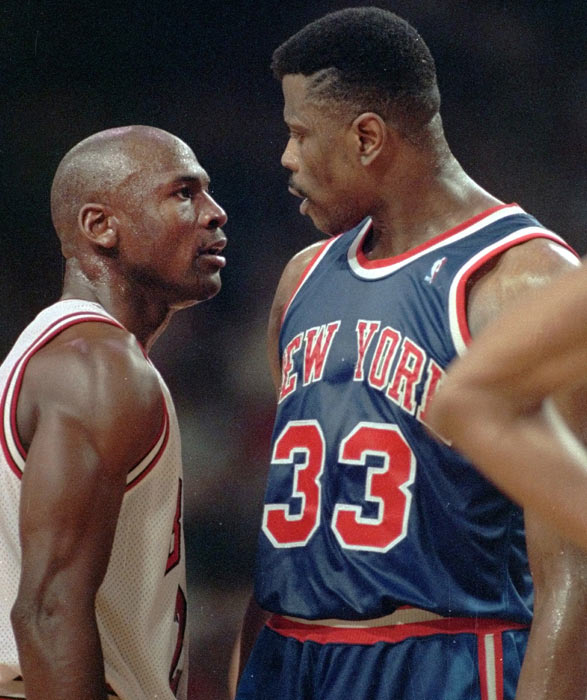 Michael Jordan and Patrick Ewing, who have competed against one another since college, exchange words and angry stares during a 1992 game between the Bulls and Knicks.