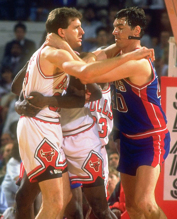 Bill Laimbeer and Will Perdue share a heated moment during a 1991 game between the Bulls and Pistons.