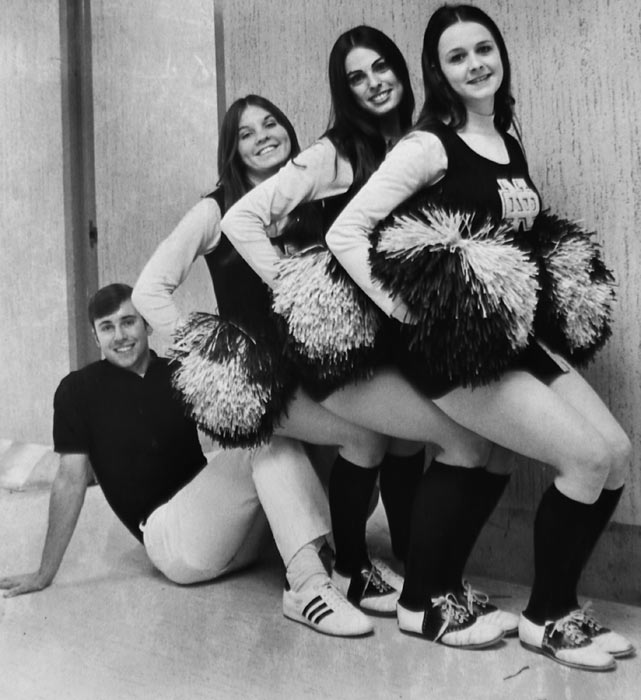 Four members of the national champion Notre Dame's 1972 cheerleading squad pose for a photo.