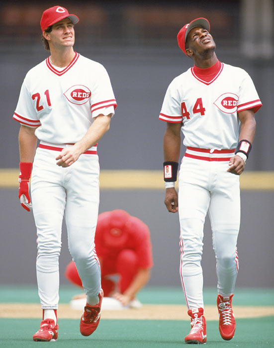 Cincinnati Reds outfielders Paul O'Neill and Eric Davis  look into the crowd before a 1991 game at Riverfront Stadium.