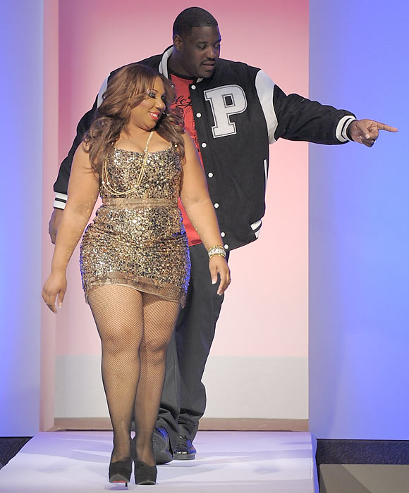 "Jets center Damien Woody and wife Nicole walk the runway during ""Tear Up the Pierre"" at New York's Pierre Hotel on Monday night."