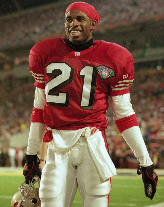 "One of the rarest of athletes to play the game, Deion Sanders dabbled in professional baseball at the same time that he was building a Hall of Fame career as a NFL cornerback. ""Prime Time"" was known for his speed, hands and return abilities. In his 13-year career, he picked off 53 passes, nine of which were returned for touchdowns, and also scored nine times as a kickoff and punt return specialist. The two-time Super Bowl champion and 1994 Defensive Player of the Year played for five teams, most prominently the Atlanta Falcons and the Dallas Cowboys."