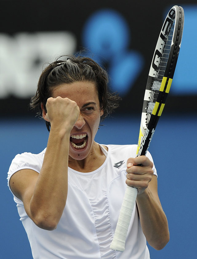 Reigning French Open champion Francesca Schiavone celebrates a point during her first-round match against Spain's Arantxa Parra Santonja. Schiavone won in three sets.