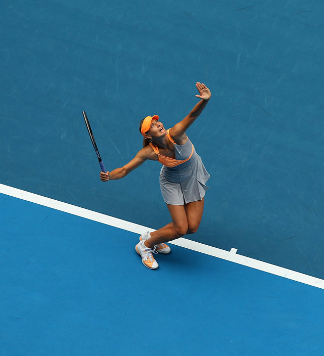 Maria Sharapova serves to Thailand's Tamarine Tanasugarn during their first-round match. Sharapova won for her first victory at Melbourne Park since 2008.