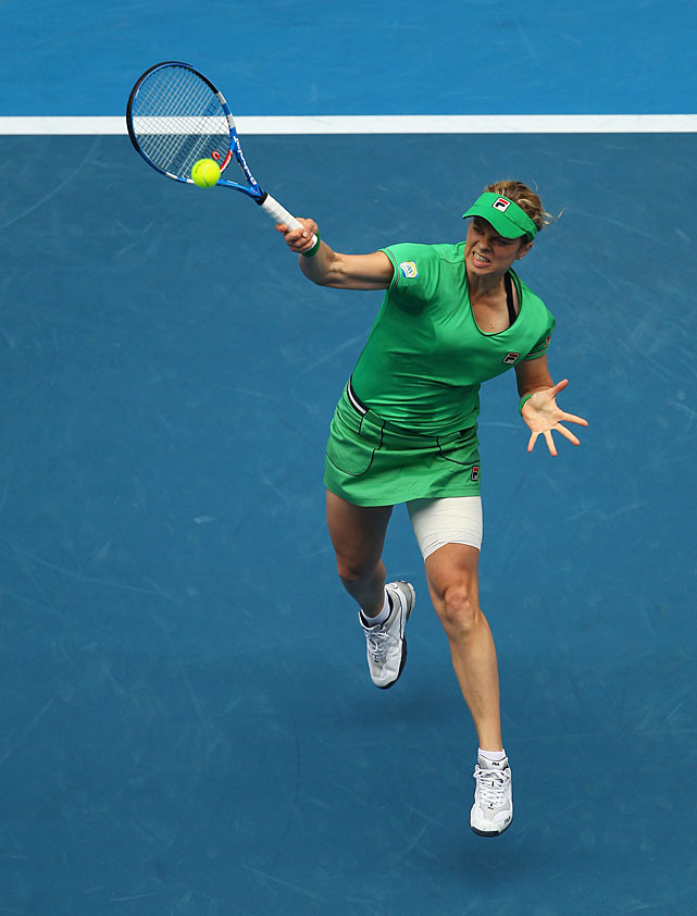 Clijsters plays a smash forehand during Wednesday's match.