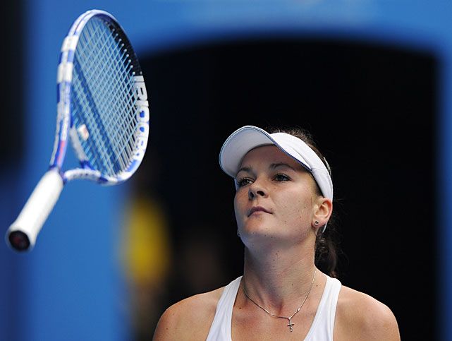 Radwanska throws her racket in frustration after losing a point to Clijsters.