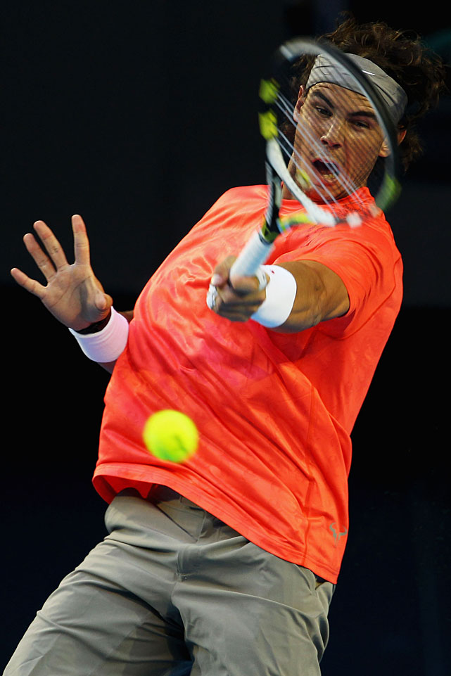 Nadal plays a forehand during his against Ferrer.