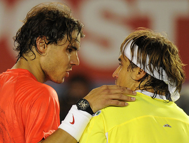 Nadal places his hands on compatriot Ferrer's shoulder after the handshake at the net.