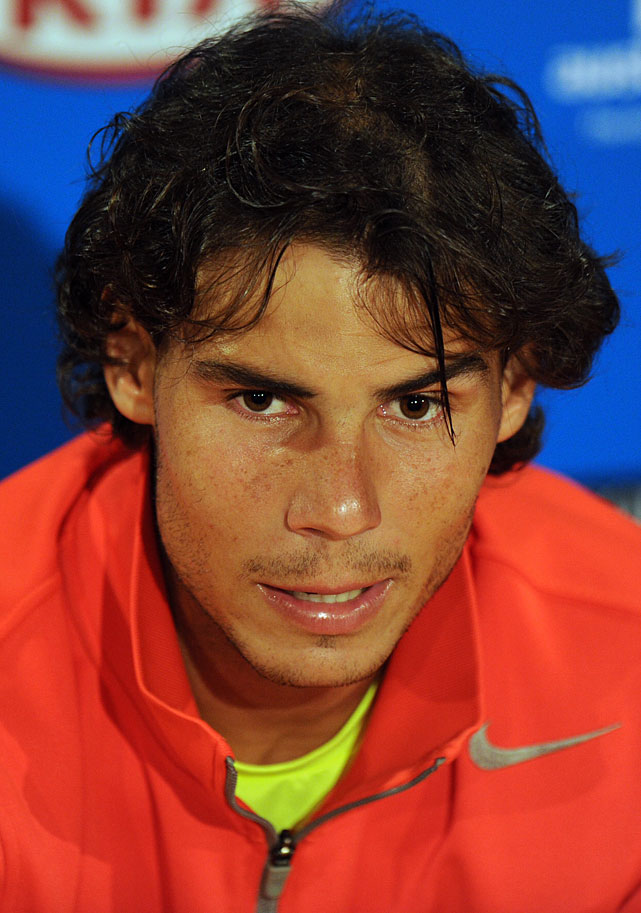 Nadal talks during his press conference after his loss to Ferrer.