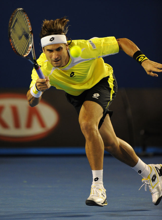 Ferrer rushes the net during Wednesday's match.