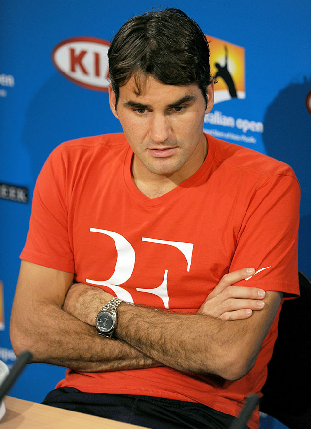 Federer speaks at a press conference after his semifinal loss to Djokovic.