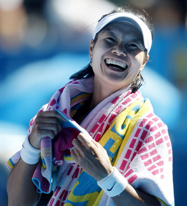 Li smiles during an on-court interview following her 3-6, 7-5, 6-3 win over Wozniacki.