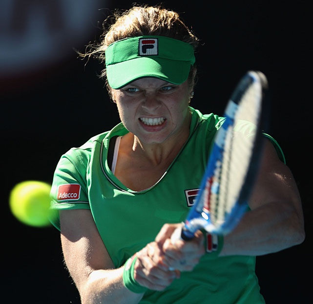 Clijsters plays a backhand to Zvonareva during their semifinal.