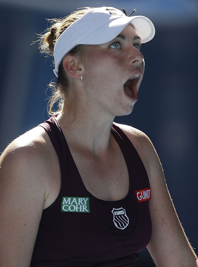 Zvonareva reacts after losing a point to Clijsters.