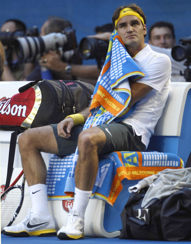 Federer towels off during a changeover.
