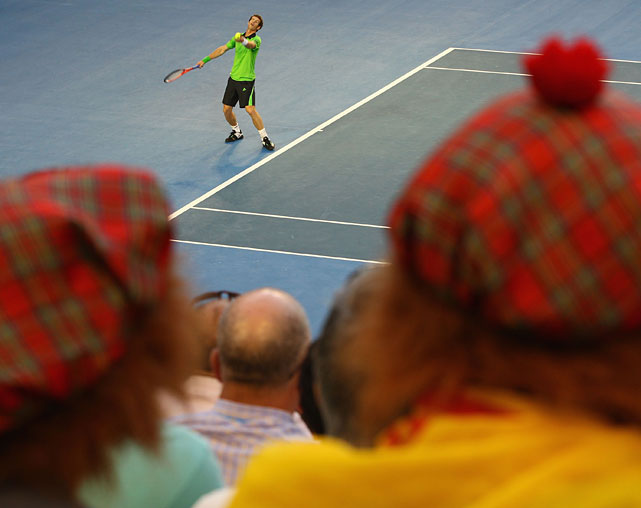 Fans in Scottish garb watch Murray play in the semifinal.