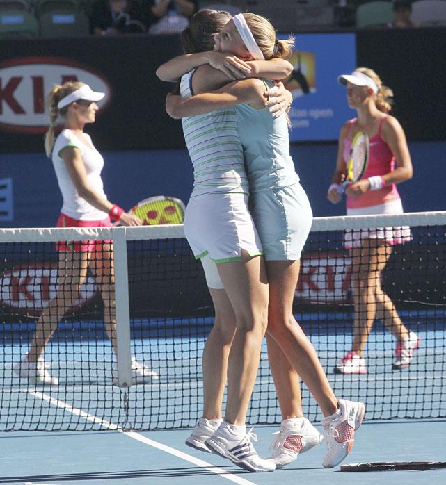 Dulko (right) and Pennetta (left) celebrate winning the women's doubles final.