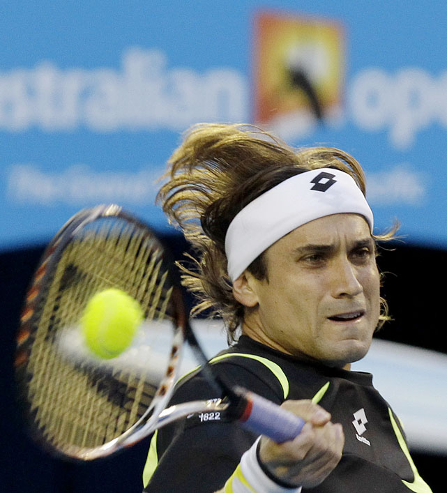 Ferrer makes a forehand return to Murray during their semifinal match.