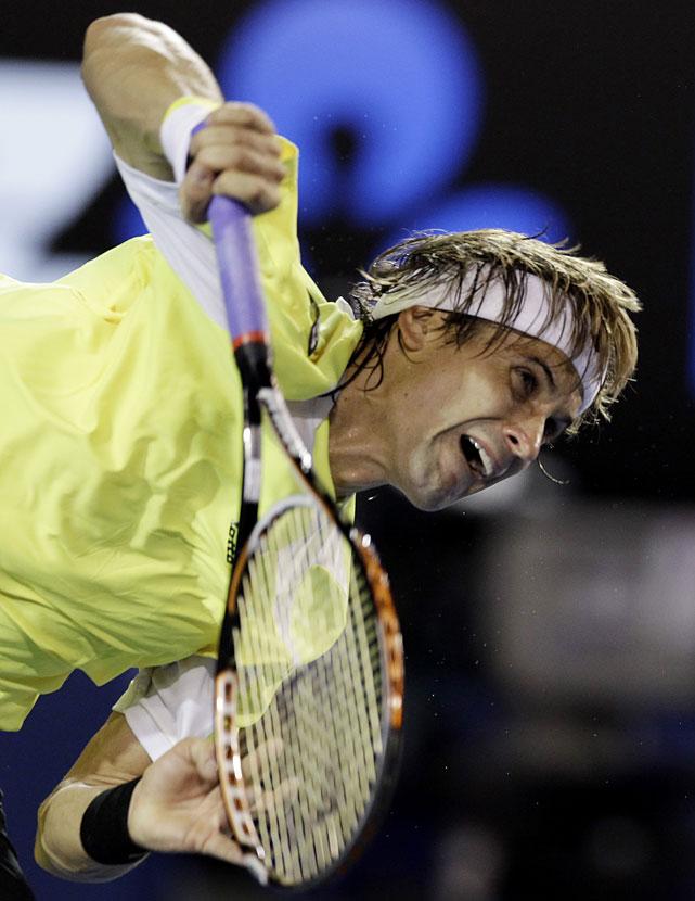 Ferrer serves during Friday's semifinal.