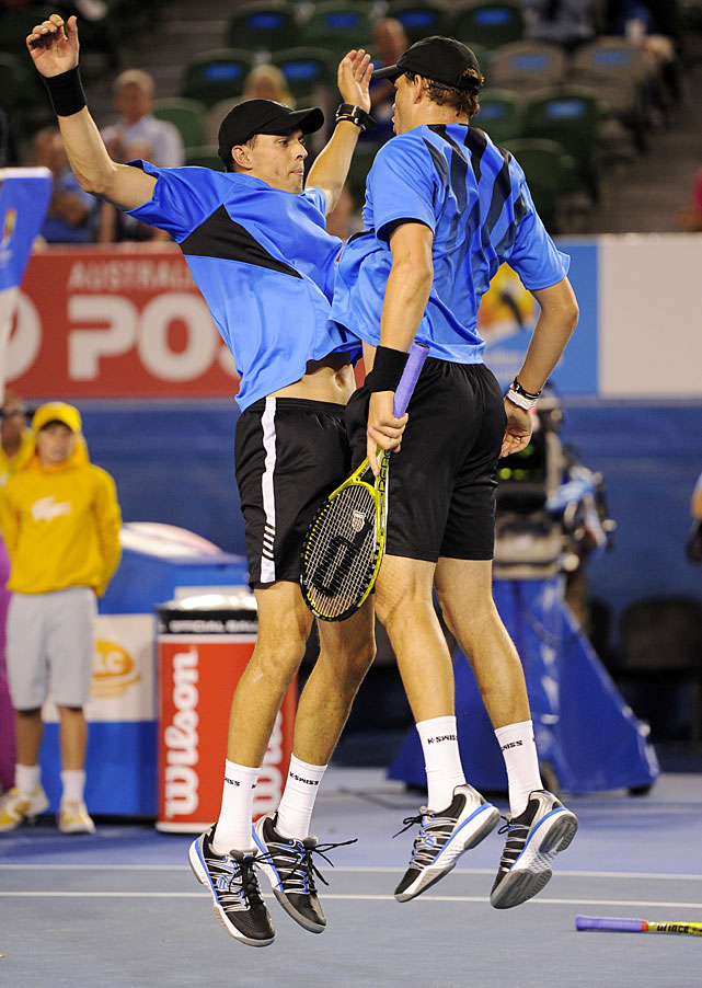 Mike Bryan celebrates with his brother Bob (right) after they defeated India's Leander Paes and Mahesh Bhupathi in the men's doubles final.