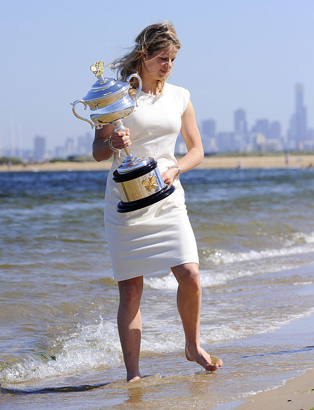 Belgium's Kim Clijsters poses for photographers with her Australian Open trophy at Melbourne's Brighton Beach.