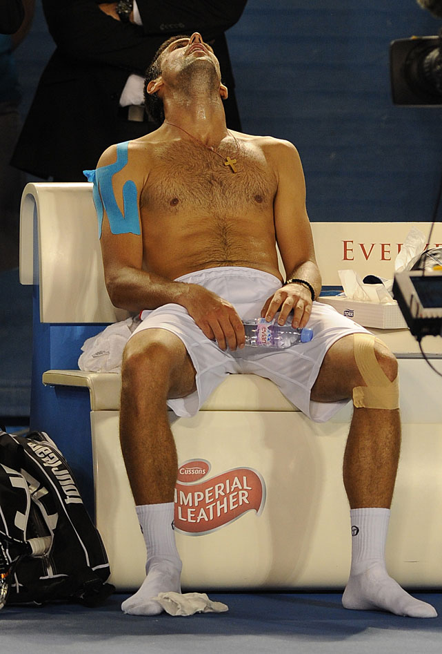 Djokovic reacts as he celebrates the victory.