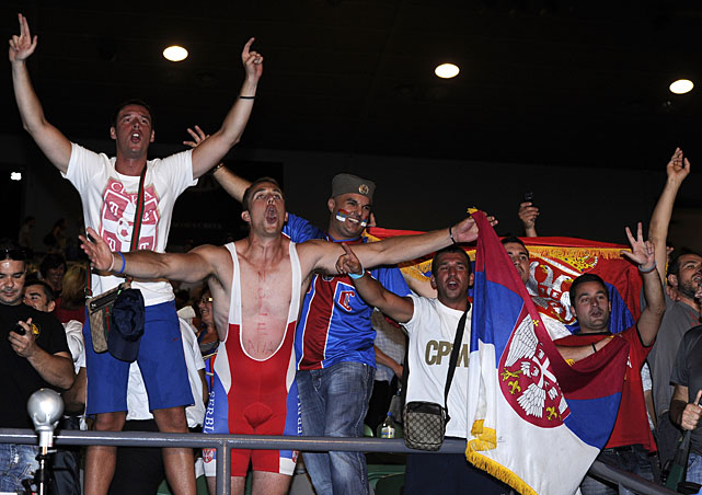 Elated Serbian fans celebrate the victory.