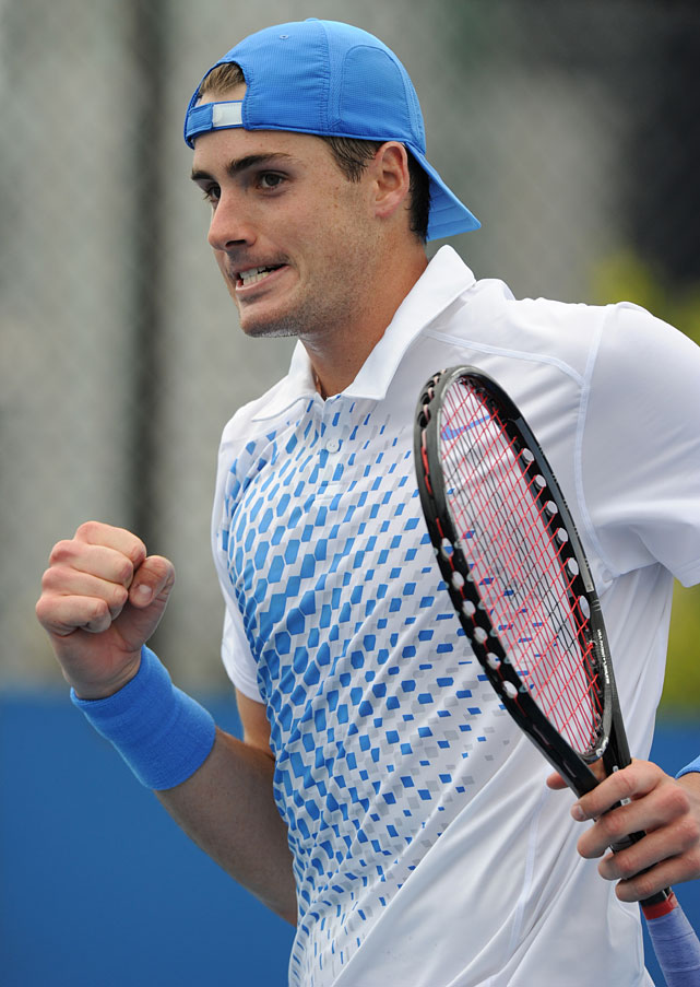 John Isner celebrates his straight-sets triumph over France's Florent Serra.