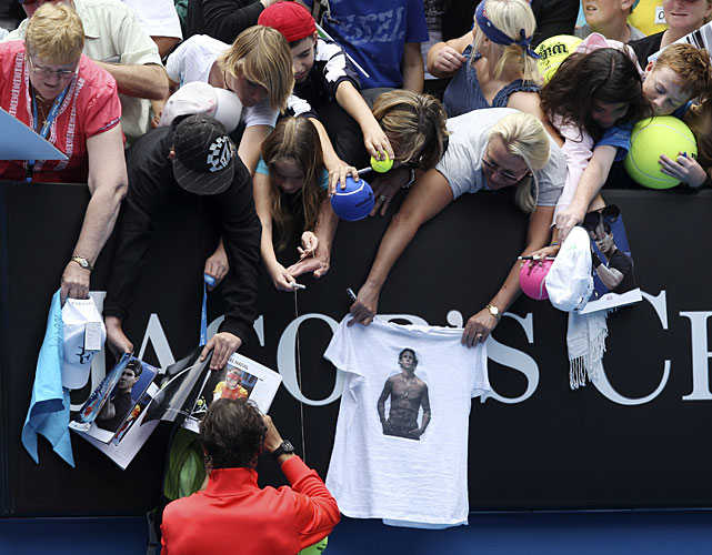 Nadal signs autographs following his first-round win over Daniel.