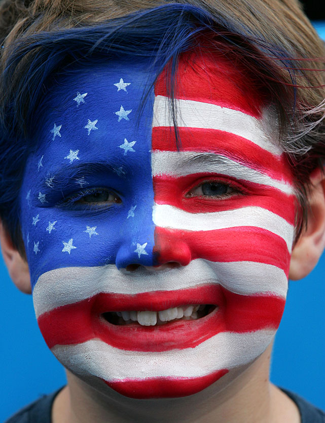 A child whose face is painted like the American flag poses at Melbourne Park.