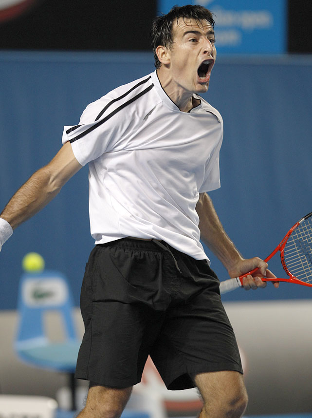 Dodig reacts after winning a point against Djokovic.