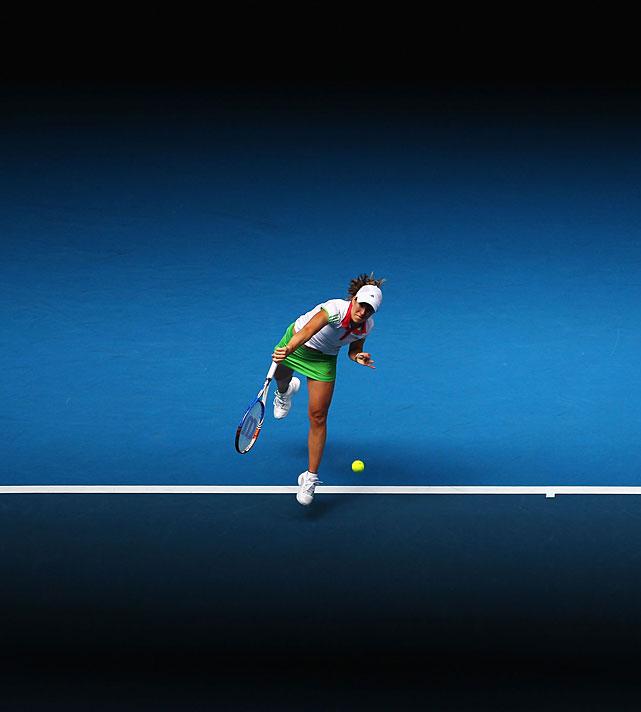 Justine Henin of Belgium serves to Great Britain's Elena Baltacha during their second-round match. Henin won 6-1, 6-3 on center court.