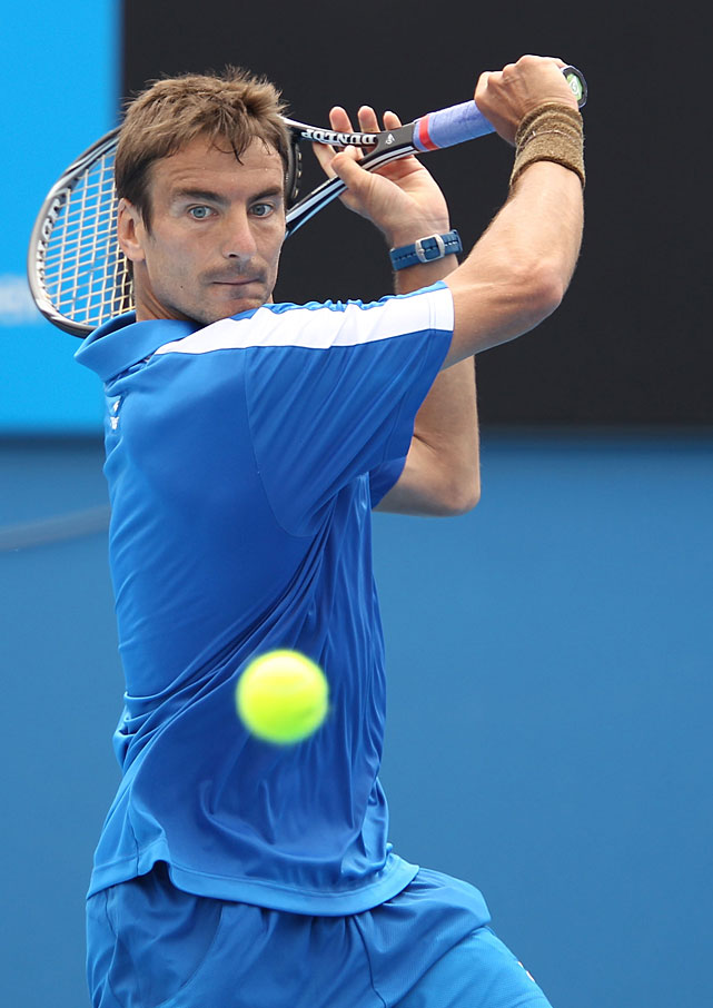Robredo plays a backhand against Fish during their second-round match.