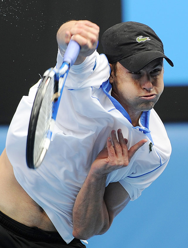 Eighth-seeded Andy Roddick returns to Russia's Igor Kunitsyn during their second-round match. Roddick won 7-6(7), 6-2, 6-3.