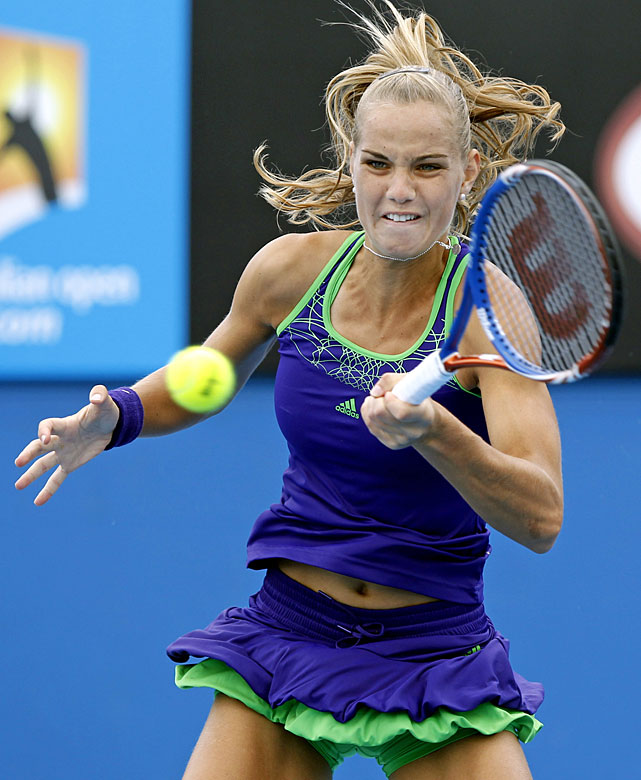 Arantxa Rus of the Netherlands returns a ball to Svetlana Kuznetsova during their second-round match.