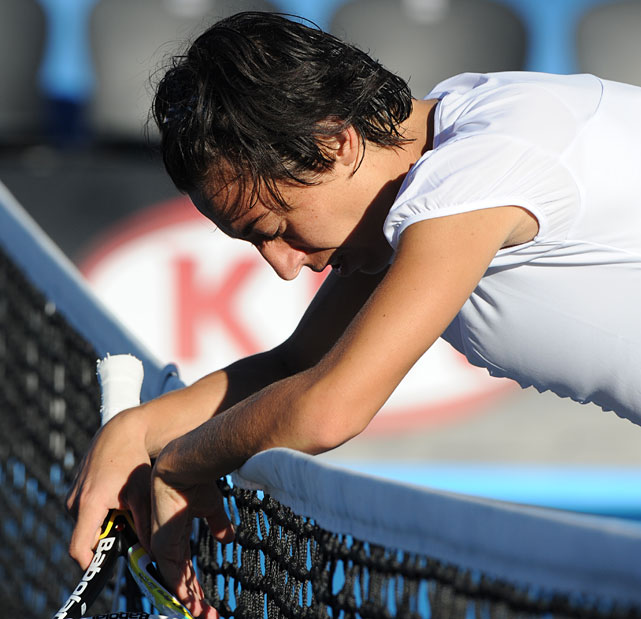 Francesca Schiavone of Italy leans on the net after beating Rebecca Marino of Canada in three sets.