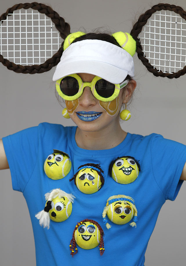 A fan wearing costume featuring tennis smiles at the Australian Open.