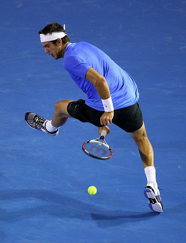 Juan Martin Del Potro of Argentina plays a shot through his legs in his second-round match against Marcos Baghdatis of Cyprus.