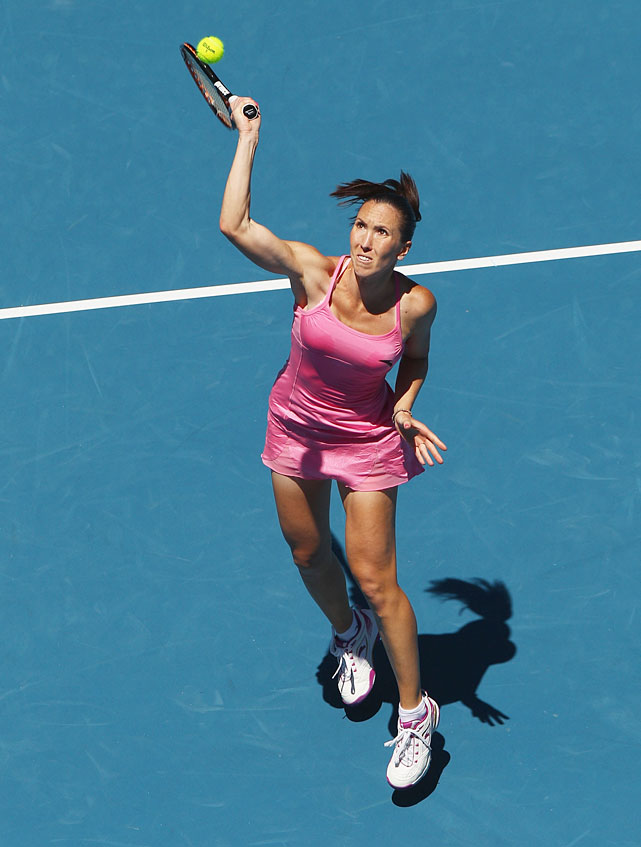 Jelena Jankovic of Serbia serves in her second-round match against Shuai Peng of China. The seventh-seeded Jankovic suffered a 7-6(3), 6-3 upset loss.