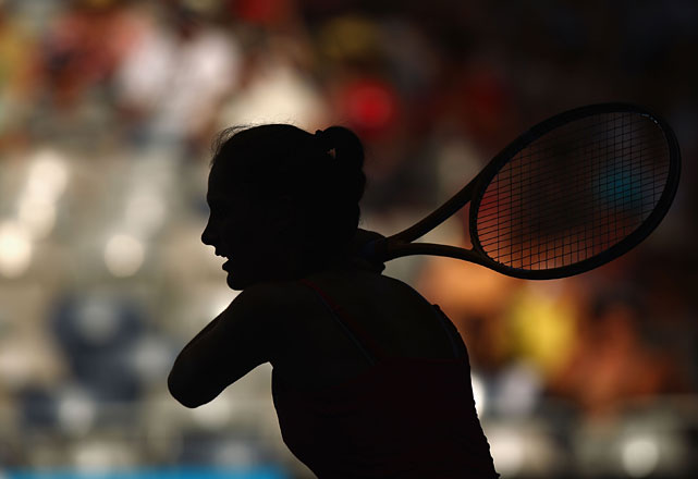 A silhouette of Bojana Jovanovski of Serbia is seen as she plays a backhand in her second-round match against Vera Zvonareva.