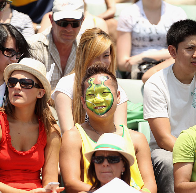 A fan has his face painted like Shrek in the crowd during the third-round match between Youzhny and Raonic.